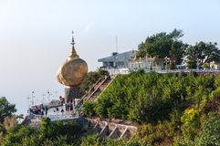 The Golden Rock, Myanmar-February 21,2014 : Kyaiktiyo Pagoda. The Golden Rock, Myanmar - February 21, 2014 : Buddhist are sittTg and waiting for worship in front Stock Photography