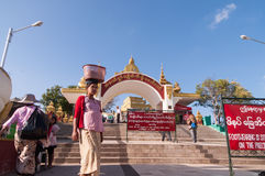 The Golden Rock, Myanmar -February 21, 2014 : Main. The Golden Rock, Myanmar - February 21, 2014 : Buddhist are sittTg and waiting for worship in front of Stock Photography
