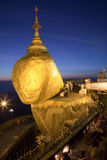 Golden rock at night. With praying people - one of the most Buddhist worship place in Burma Royalty Free Stock Photos