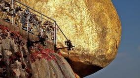 Golden Rock with row of traditional golden wind bells. Myanmar (Burma) travel stock footage