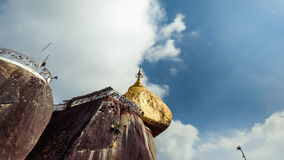 Golden Rock with traditional wind bells under blue sky. Myanmar. Time lapse stock video footage