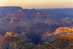 Golden Rocks of the Grand Canyon in Sunset. Fantastic view into the grand canyon from mathers point, south rim royalty free stock images
