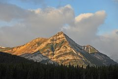 Golden rocky mountains Stock Images