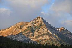 Golden rocky mountains Stock Image