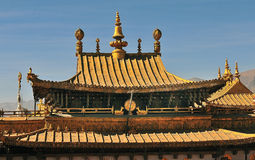 The golden roof of Jokhang Monastery in Lhasa. Buddhist banners hanging from the celling of the hall in he monastery Stock Photography