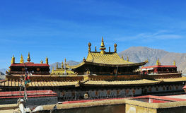 The golden roof of Dazao Monastery in Lhasa. Buddhist banners hanging from the celling of the hall in he monastery Stock Photo
