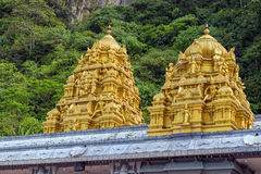 Golden roof on Indian temple in Batu Caves, Kuala Lumpur. Golden roof on Indian temple, Sri Subramaniar Hindu Temple Dome Detail at Batu Caves in Kuala Lumpur Royalty Free Stock Photos