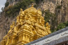 Golden roof on Indian temple in Batu Caves, Kuala Lumpur. Golden roof on Indian temple Sri Subramaniar Hindu Temple Dome Detail at Batu Caves in Malaysia Royalty Free Stock Images