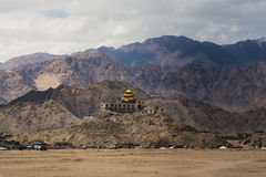 Golden roof monastery in Leh Ladakh. Leh, a high-desert city in the Himalayas, is the capital of the Leh region in northern India's Jammu and Kashmir state Stock Image