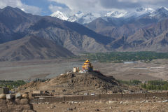 Golden roof monastery and snow mountain range Leh Ladakh ,India Royalty Free Stock Photo