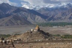 Golden roof monastery and snow mountain range Leh Ladakh ,India Royalty Free Stock Photo