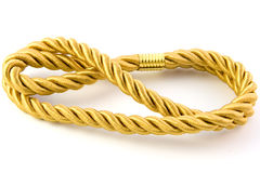 Golden rope. Isolated on white background Stock Photo
