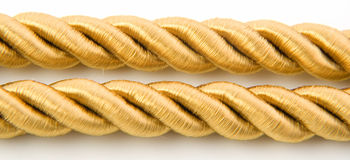 Golden rope. Isolated on white background Stock Photos