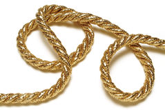 Golden rope. Isolated on white Stock Photography