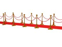 Golden rope barrier with red event carpet Royalty Free Stock Image