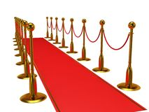 Golden rope barrier with red event carpet Royalty Free Stock Photo