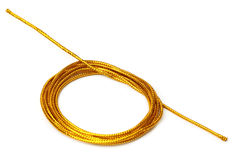 Golden rope over white background Royalty Free Stock Photography