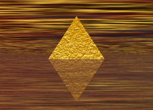 Golden Rough Pyramid on Stripes Stock Photography