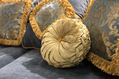 Golden round cushion. The golden round cushion on a sofa royalty free stock photography