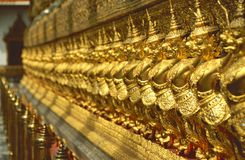 Golden Row Of Buddhist Temple Keepers Royalty Free Stock Images