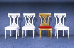 Golden royal chair against wal. Golden luxury royal chair different from white ones against blue wall Stock Images