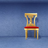 Golden royal chair against wal. Golden luxury royal chair alone against blue wall Royalty Free Stock Image