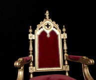 Golden royal chair isolated on black Royalty Free Stock Photos