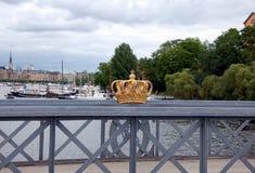 A golden Royal Crown. On the Skeppsholmsbron bridge in Stockholm, Sweden Stock Photography