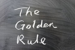The golden rule. Words written on the chalkboard Stock Photos