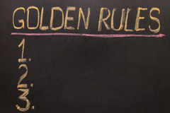 Golden Rules - on the blackboard with chalk. And a checklist Stock Image