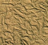 Golden rumpled texture Royalty Free Stock Image