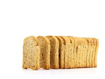 Golden rusk. On white background Stock Images