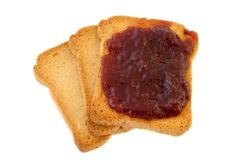 Golden rusk and jam. Texture of three golden rusk and ruspberry jam Royalty Free Stock Photo