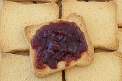 Golden rusk and raspberry jam. Background of golden rusk and raspberry jam Royalty Free Stock Image