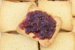 Golden rusk and raspberry jam. Background of golden rusk and raspberry jam Royalty Free Stock Images