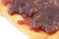 Golden rusk and raspberry jam. Macro of golden rusk and raspberry jam Royalty Free Stock Photography