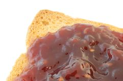 Golden rusk and raspberry jam. Macro of golden rusk and raspberry jam Royalty Free Stock Photos