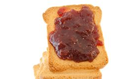 Golden rusk and raspberry jam. Still life of golden rusk with red raspberry jam Royalty Free Stock Image