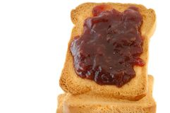 Golden rusk and raspberry jam. Still life of golden rusk with red raspberry jam Stock Photography
