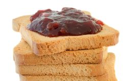Golden rusk and raspberry jam. Still life of golden rusk with red raspberry jam Stock Photo