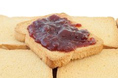 Golden rusk and raspberry jam. With white background Royalty Free Stock Photo
