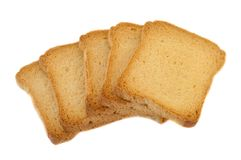 Golden rusk. Still life of golden rusk in a white background Royalty Free Stock Photos