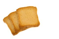 Golden rusk. Still life of golden rusk in a white background Royalty Free Stock Photo
