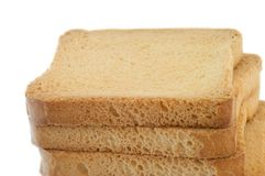 Golden rusk. Still life of golden rusk in a white background Stock Image