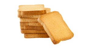 Golden rusk. Still life of golden rusk in a white background Stock Images