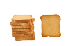 Golden rusk. Still life of golden rusk in a white background Royalty Free Stock Images