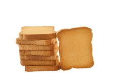 Golden rusk. Still life of golden rusk in a white background Stock Photos