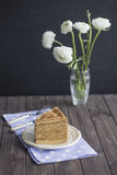 Golden Russian pancakes napkin with dark background Ranunkulyus buttercup bouquet Stock Image