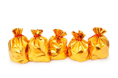 Golden sacks full of good. Golden sacks full of something good stock photography