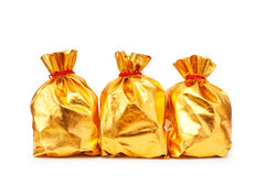 Golden sacks full of  good Stock Photography